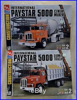 AMT INTERNATIONAL PAYSTAR 5000 DUMP TRUCK AND CEMENT MIXER NEW SEALED LOT OF 2