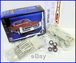 LOT 13 Three (3) different 1/25 scale AMT/ERTL & LINDBERG MODEL CAR kits
