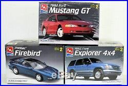 LOT 4 Three (3) different 1/25 scale AMT/ERTL FORD & PONTIAC MODEL CAR kits