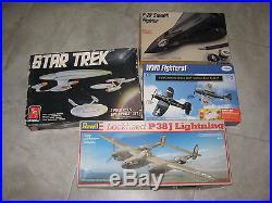Lot of 4 Model Airplane Kits Revell AMT Testors Italari f-19 Stealth Star Trek